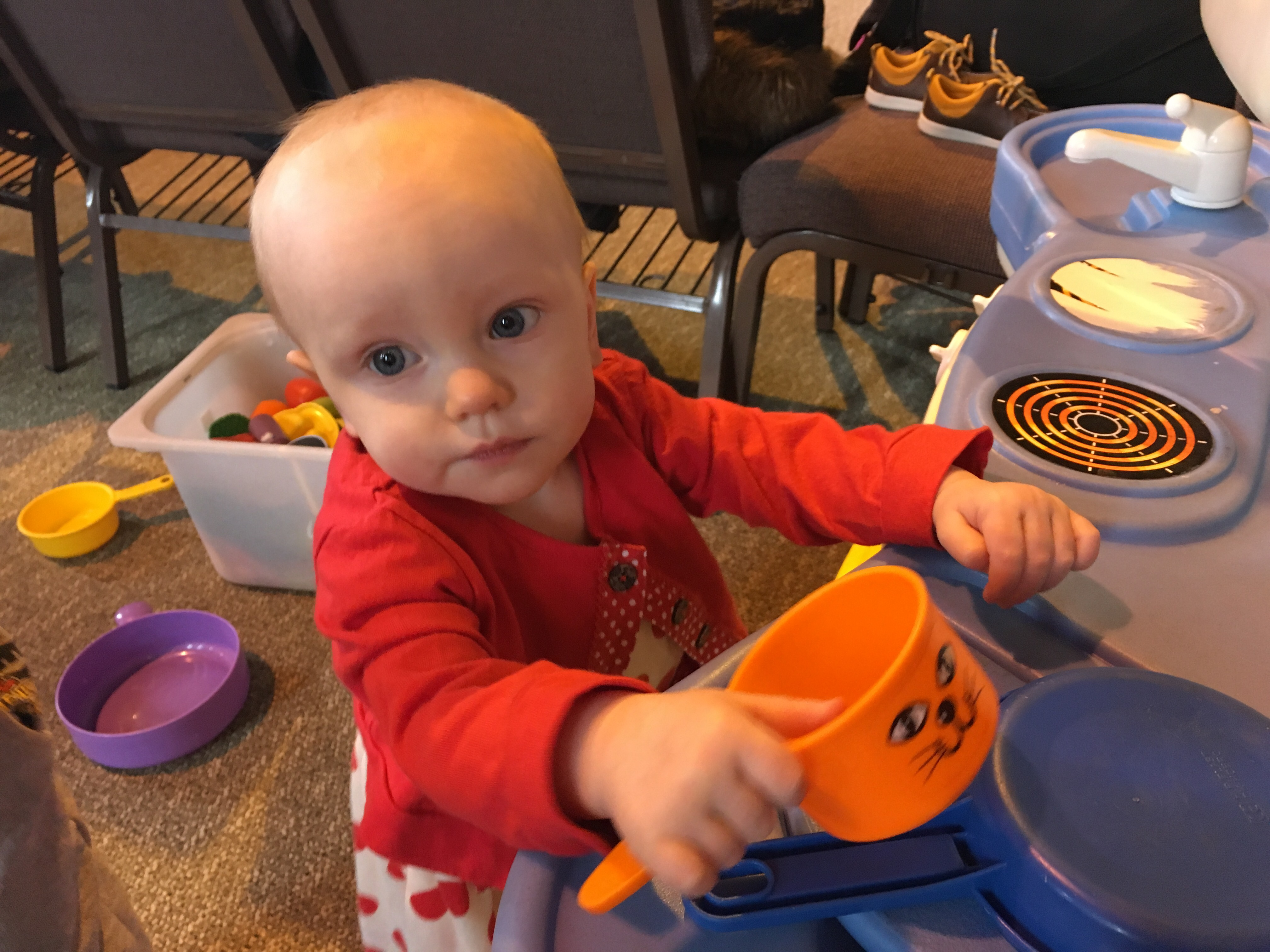 Baby Lena playing with toy kitchen