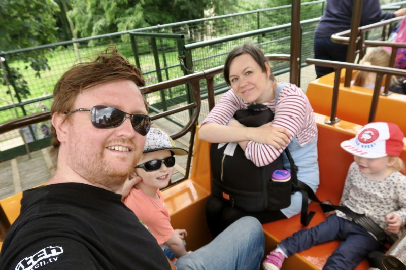 Flamingo Land Holiday Resort review - a family of 4 looking happy on a mono-rail ride at Flamingo land