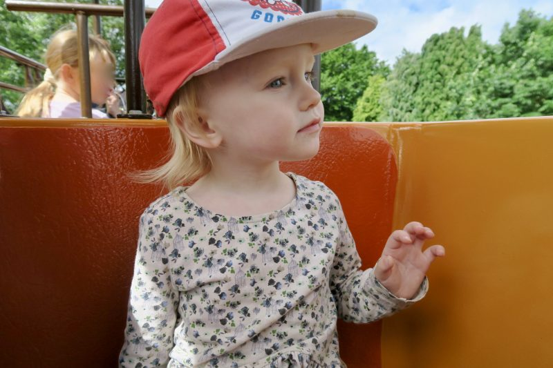 a 2 year old girl sat on the mono-rail ride at Flamingo Land