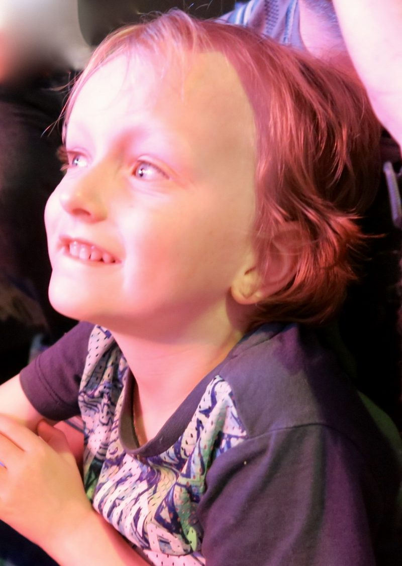 A 5 year old boy smiling whilst watching the kids entertainment at Flamingo Land Holiday Resort