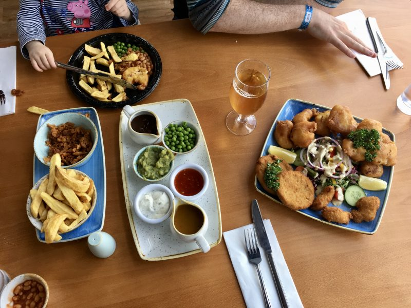 a table with fish and chips from the Upper Deck Fish Restaurant at Flamingo Land