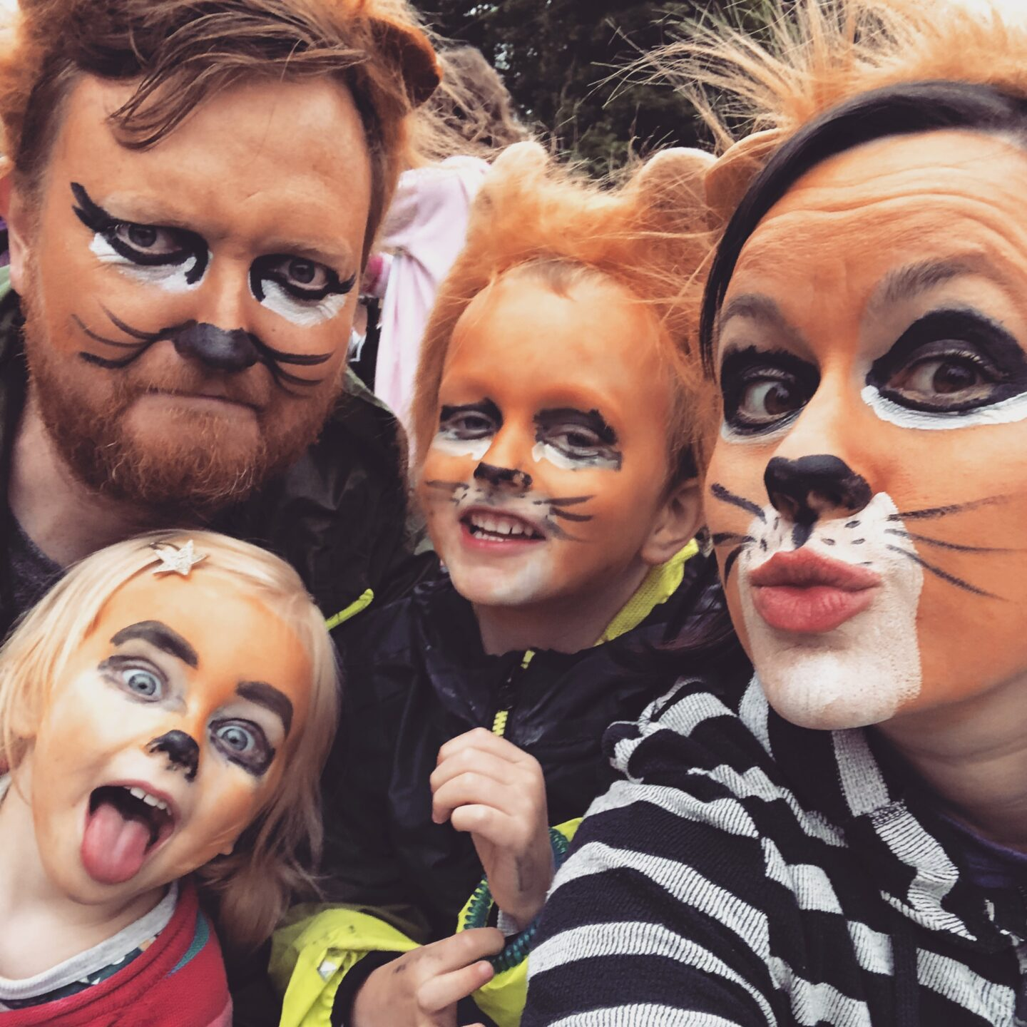 Just So Festival 2018 review and our top tips for Just So Festival - family with lion face paint