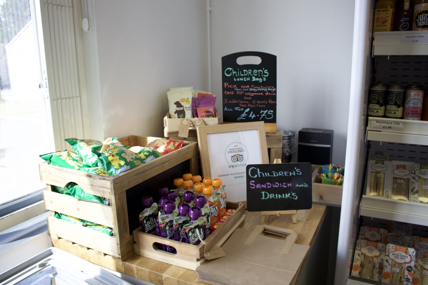 Children's food options in the cafe including jelly pouches, pom bear crisps, fruit roll ups - lunch bags priced £4.75