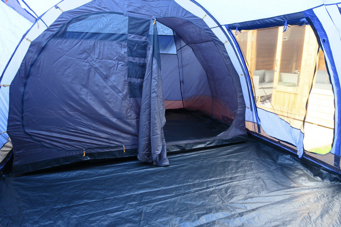 The inside of a blue tent showing a separate sleeping compartment