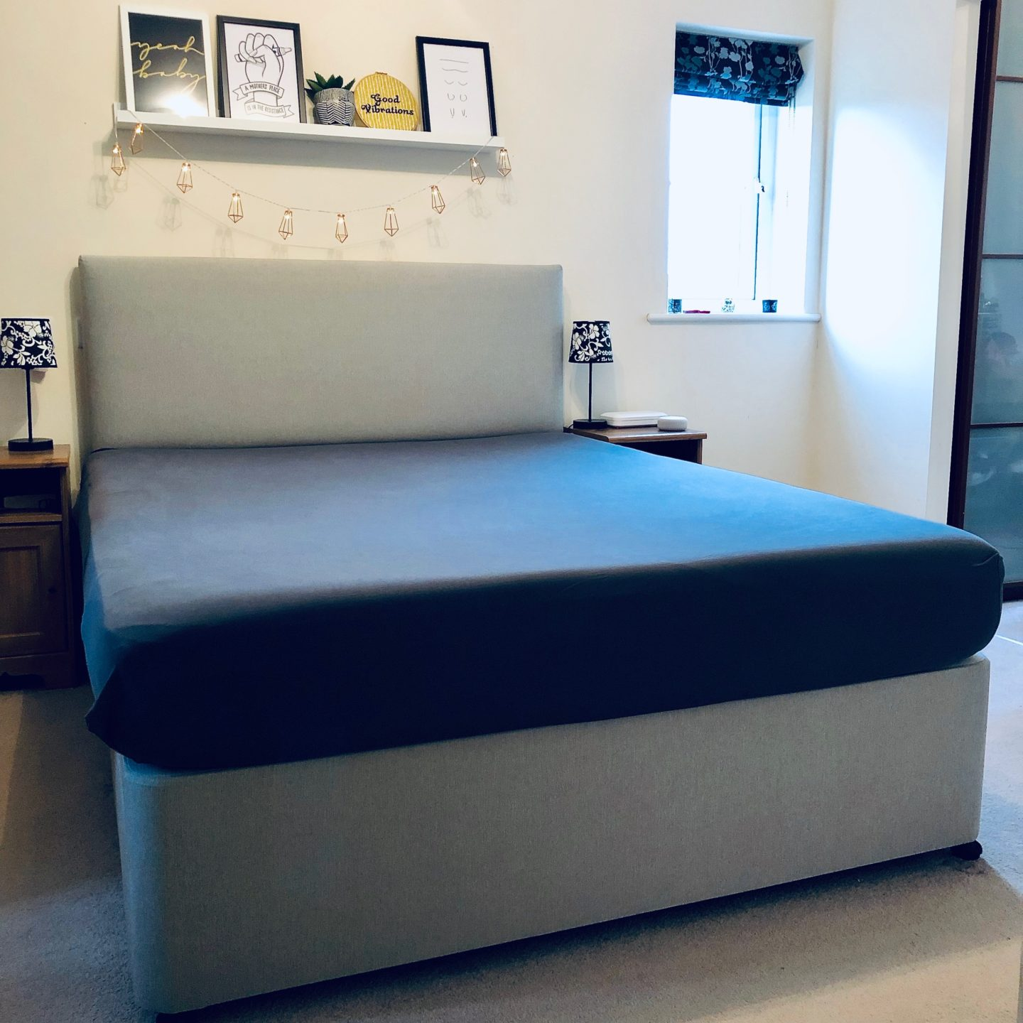 The Emma Mattress with a grey fitted sheet applied. The mattress looks wide and deep.